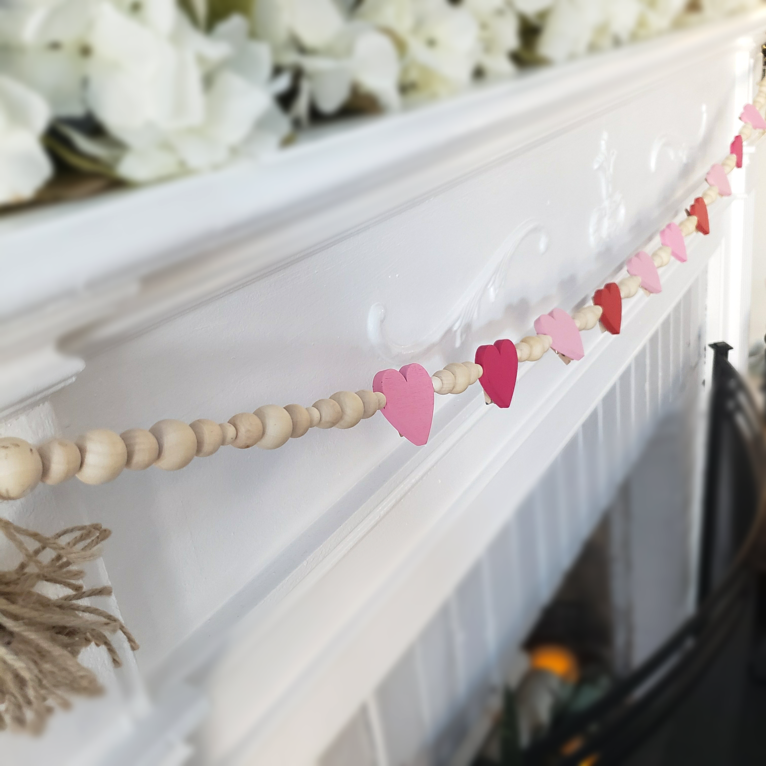 diy wooden heart bead garland on mantle